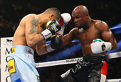 LAS VEGAS, NV - MAY 3: Floyd Mayweather Jr. (green/white flag trunks) and Marcos Maidana (blue trunks) during their WBA/WBC welterweight unification fight at the MGM Grand Garden Arena on May 3, 2014 in Las Vegas, Nevada. (Photo by Ed Mulholland/Golden Boy/Golden Boy via Getty Images) *** Local Caption ***Floyd Mayweather Jr.; Marcos Maidana