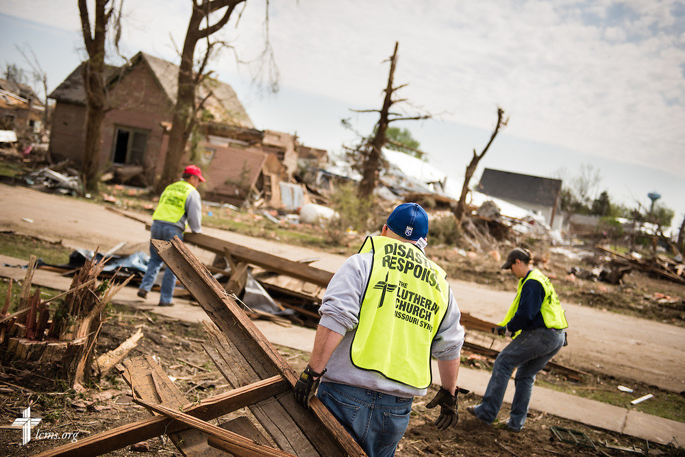 Parishioners and volunteers remove debris surrounding Zion Lutheran Church on Tuesday, May 12, 2015, in Delmont, S.D. A tornado swept through the area on Sunday and destroyed the church along with nearby buildings. LCMS Communications/Erik M. Lunsford