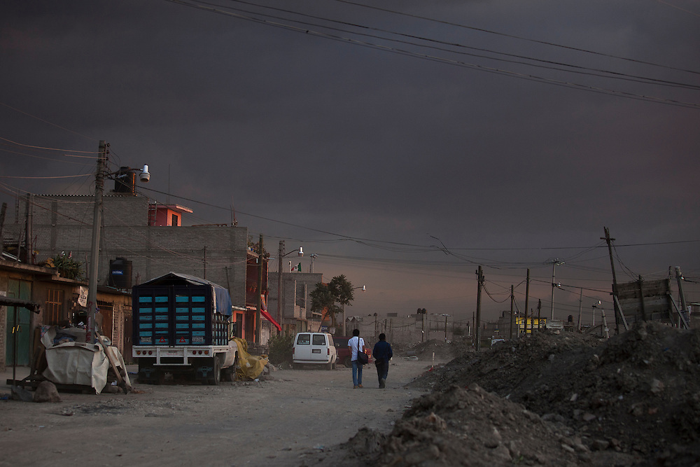 A dusty makeshift street on the edge of Lake Texcoco shows the population boom surrounding mexico city.
