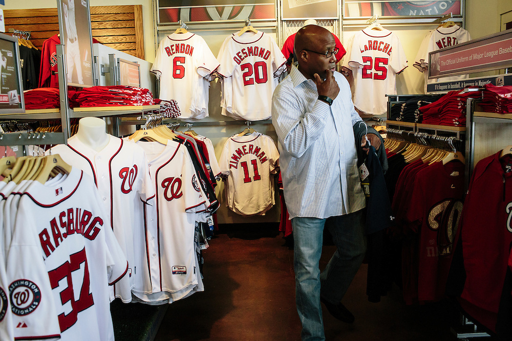 """Barry Walton, a Washington D.C. native, searches for Washington Nationals jerseys at the Nationals Clubhouse Team Store on Sept. 18, 2014. """"I get tired of seeing Orioles gear,"""" Walton, who works at a Maryland-based company, said. """"I want to shove it down their necks."""""""