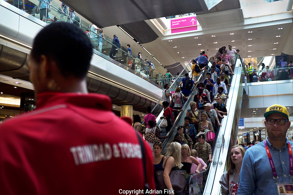 A supporter of Trinidad and Tobago stands amongst others in the Westfield shopping centre in Stratford close to the Olympic Park