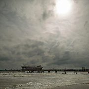 NORFOLK, VA - JULY 4: The sun attempts to peek out from the clouds over the Ocean View Fishing Pier as Hurricane Arthur leaves Hampton Roads on Friday, July 4th, 2014 in Norfolk, Va. (Photo by Jay Westcott/For The Virginian-Pilot)