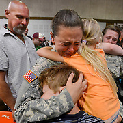 Photo by Gary Cosby Jr.  Ashleigh Holt cries as she hugs her brother Tyler and sister Skylar during the deployment ceremony for the 152nd Military Police company of the Alabama Army National Guard unit based in Hartselle Sunday, June 24, 2012 at the Sparkman Civic Center.  Their father, Travis Holt, is at left.