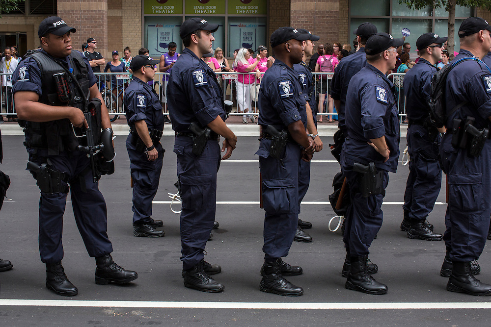 Police keep watch over a pro-choice demonstration outside the Democratic National Convention on Tuesday, September 4, 2012 in Charlotte, NC.