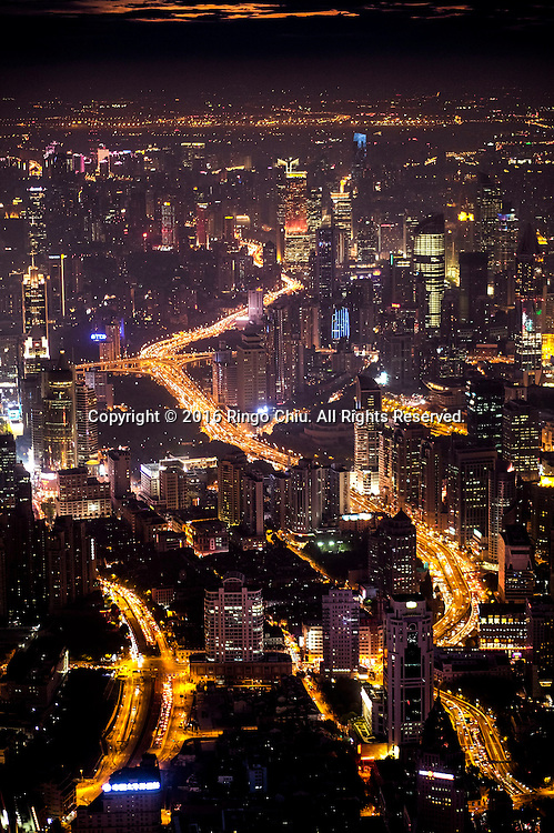 The Shanghai skyline with freeways are viewed from the Shanghai Tower in Shanghai, China. Shanghai is the most populous city in China and the most populous city proper in the world. It is one of the four direct-controlled municipalities of China, with a population of more than 24 million as of 2014. It is a global financial centre, and a transport hub with the world's busiest container port. Located in the Yangtze River Delta in East China, Shanghai sits on the south edge of the mouth of the Yangtze in the middle portion of the Chinese coast. The municipality borders the provinces of Jiangsu and Zhejiang to the north, south and west, and is bounded to the east by the East China Sea. A major administrative, shipping, and trading town, Shanghai grew in importance in the 19th century due to trade and recognition of its favourable port location and economic potential. The city was one of five forced open to foreign trade following the British victory over China in the First Opium War while the subsequent 1842 Treaty of Nanking and 1844 Treaty of Whampoa allowed the establishment of the Shanghai International Settlement and the French Concession. The city then flourished as a center of commerce between China and other parts of the world (predominantly Western countries), and became the primary financial hub of the Asia-Pacific region in the 1930s. However, with the Communist Party takeover of the mainland in 1949, trade was limited to socialist countries, and the city's global influence declined. In the 1990s, the economic reforms introduced by Deng Xiaoping resulted in an intense re-development of the city, aiding the return of finance and foreign investment to the city. Shanghai has been described as the &quot;showpiece&quot; of the booming economy of mainland China; renowned for its Lujiazui skyline, museums and historic buildings, such as those along The Bund, the City God Temple and the Yu Garden.(Photo by Ringo Chiu/PHOTOFORMULA.com)<br /> <br /> Usage Notes: This 