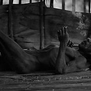A very contented Korowai man relaxes with a smoke.