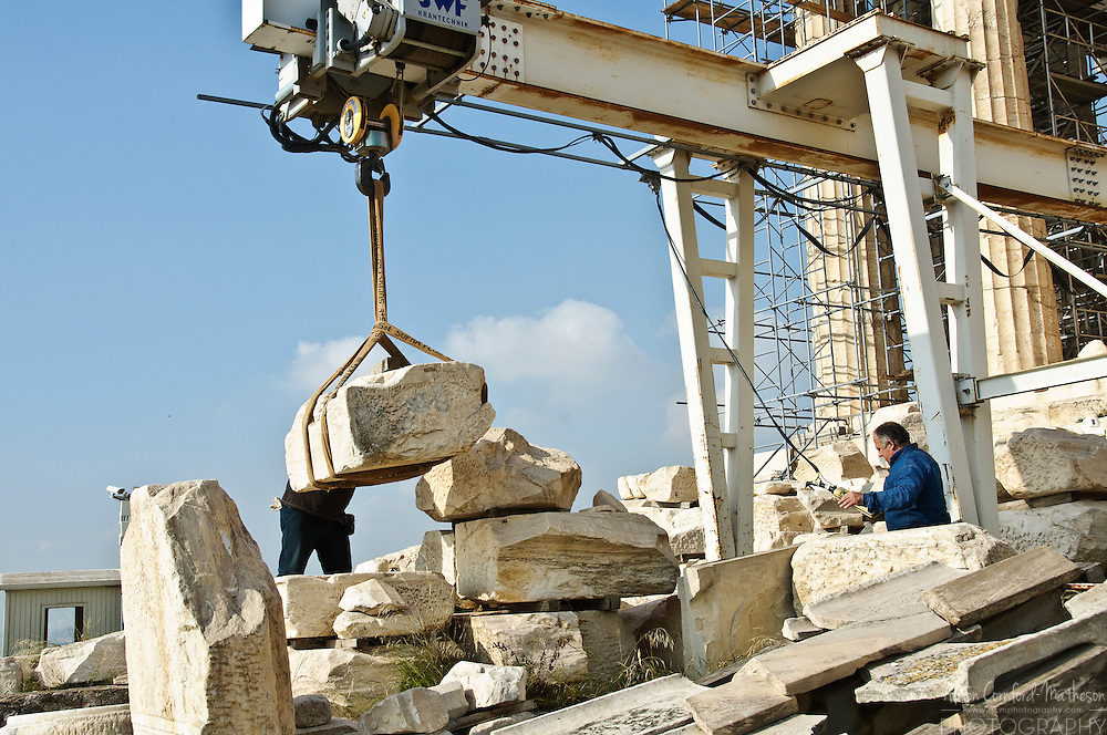 A stone is lifted by a pulley at the Acropolis in Athens Greece.