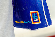Person Hold an Aldi Supermarket Carrier Bag - Apr 2015.