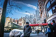 woman bundled up in a winter coat as she walks on the Upper West Side of New York City