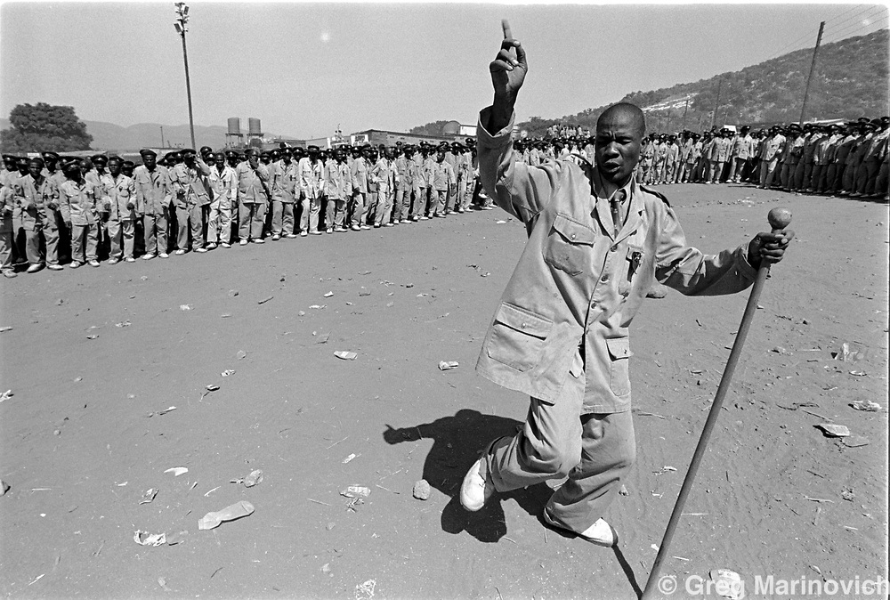Zion Christian Church members dance at the ZCC headquarters for the easter celebration in April 1994. The ZCC has millions of adherants, some two to three million of whom gather in the Northern Province of South Africa twice a year. (Greg Marinovich)