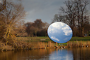 Anish Kapoor, Sky Mirror 2006, Stainless steel,1066.8 x 1066.8 cm. Installation view of Serpentine Gallery exhibition Turning the World Upside Down, Kensington Gardens, London 28 September 2010 - 13 March 2011