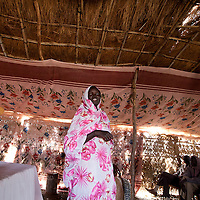 A recent returnee from Khartoum gives a speech in a church.