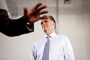 GOP presidential candidate Gov. Mitt Romney is introduced at a campaign rally at EIT LLC, and electronics design and manufacturing company, in Sterling, Virginia, June 27, 2012.