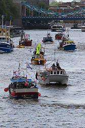 London Bridge, London, June 15th 2016. A flotilla of fishing boats led by UKIP's Nigel Farage heads through Tower Bridge in protest against the EU's Common Fisheries Policy and in support of Britain leaving the EU. PICTURED: Fishing boats head up the River Thames