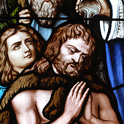 Stained glass image showing baptism of St. Paul of Tarsus. (Sam Lucero photo)