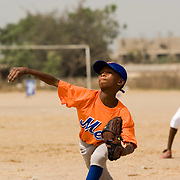 Ghanaian children play baseball during an exhibition match in Tema, roughly 35 km east of Ghana's capital Accra on Saturday February 3, 2007. The game was being held on the occasion of the visit of a delegation from the American Major League Baseball Association made possible by the African Development Foundation, a non-profit organization that supports little league projects in selected African countries.
