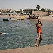 boys in the red sea in Aqaba, Jordan, may 13, 2013. Photo by Oren Nahshon