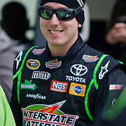 Kyle Busch smiles for the carmers prior to the start of the 42 Annual Sprint Cup Series Sunday, Oct. 02, 2011 at Dover International Speedway in Dover Delaware.