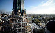 HOLD FOR RUSS BYNUM STORY- On scaffolding 120 feet above downtown Savannah, construction superintendent Fred Russell walks the north tower during his morning inspection of the work in progress at the historic Cathedral of St. John the Baptist, Tuesday, March 19, 2013 in Savannah, Ga. The church's Gothic architecture has been covered by 16 flights of scaffolding since January. (AP Photo/Stephen Morton)