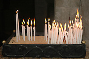 candles in the Interior of the church of the Holy Sepulchre, Old city, Jerusalem, Israel