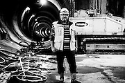 Head foreman Ries Jelier stands for a portrait in the underground works of the new north/south metro line being built in Amsterdam. Image © Angelos Giotopoulos/Falcon Photo Agency.
