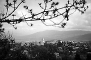 """A view down to Shushi. This image is part of the photoproject """"The Twentieth Spring"""", a portrait of caucasian town Shushi 20 years after its so called """"Liberation"""" by armenian fighters. In its more than two centuries old history Shushi was ruled by different powers like armeniens, persians, russian or aseris. In 1991 a fierce battle for Karabakhs independence from Azerbaijan began. During the breakdown of Sowjet Union armenians didn´t want to stay within the Republic of Azerbaijan anymore. 1992 armenians manage to takeover """"ancient armenian Shushi"""" and pushed out remained aseris forces which had operate a rocket base there. Since then Shushi became an """"armenian town"""" again. Today, 20 yeras after statement of Karabakhs independence Shushi tries to find it´s opportunities for it´s future. The less populated town is still affected by devastation and ruins by it´s violent history. Life is mostly a daily struggle for the inhabitants to get expenses covered, caused by a lack of jobs and almost no perspective for a sustainable economic development. Shushi depends on donations by diaspora armenians. On the other hand those donations have made it possible to rebuild a cultural centre, recover new asphalt roads and other infrastructure. 20 years after Shushis fall into armenian hands Babies get born and people won´t never be under aseris rule again. The bloody early 1990´s civil war has moved into the trenches of the frontline 20 kilometer away from Shushi where it stuck since 1994. The karabakh conflict is still not solved and could turn to an open war every day. Nonetheless life goes on on the south caucasian rocky tip above mountainious region of Karabakh where Shushi enthrones ever since centuries."""