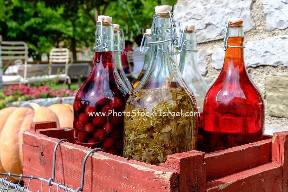 A selection of home made liqueurs photographed in a traditional tavern in Kastoria, Macedonia, Greece