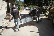 Volunteers preparing a coffin for a body of a kid found under the debries of his house with his family in Saletta few kilometers from Amatrici. A 6,4 earthquake has hit central Italy during the night between the 23 and 24 August killing more than 100. The town of Amatrice is been heavily damaged.
