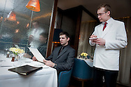 UK. London. A waiter taking orders in Corrigan's Restaurant in Central London..Photo©Steve Forrest/Workers' Photos.
