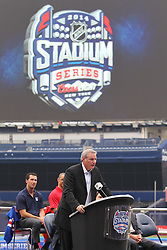Aug 8, 2013; New York, NY, USA; New York Islanders General Manager Garth Snow speaks at a press conference at Yankee Stadium. Two outdoor regular-season NHL games will be played at Yankee Stadium during the 2013-14 season as part of the 2014 Stadium Series.