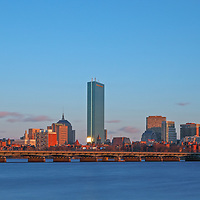 Stunning Boston skyline panorama photography from New England based skyline photographer Juergen Roth. This Boston panorama photography image shows familiar Boston landmarks such as the Prudential Center and 200 Clarendon office building formerly known as John Hancock Tower in the Back Bay, the Massachusetts State House and the newly constructed Millennium Tower in Beacon Hill as seen from Cambridge, MA. Memorial Drive one of Boston best photo locations. <br /> <br /> Boston panorama photography images are available as museum quality photo prints, canvas prints, acrylic wall art prints, wood image prints or metal fine art prints. Fine art prints may be framed and matted to the individual liking and decorating needs:<br /> <br /> https://juergen-roth.pixels.com/featured/boston-golden-hour-juergen-roth.html<br /> <br /> All Boston panorama photos are available for digital photography image licensing at www.RothGalleries.com. The image can also be printed as very large art prints and used for murals. Please contact me direct with any questions or request. <br /> <br /> Good light and happy photo making!<br /> <br /> My best,<br /> <br /> Juergen<br /> Image Licensing: http://www.RothGalleries.com <br /> Fine Art Prints: http://juergen-roth.pixels.com<br /> Photo Blog: http://whereintheworldisjuergen.blogspot.com<br /> Twitter: https://twitter.com/naturefineart<br /> Facebook: https://www.facebook.com/naturefineart <br /> Instagram: https://www.instagram.com/rothgalleries