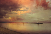 Evening sun and heavy clouds after a thunderstorm at Sanur Beach, Bali