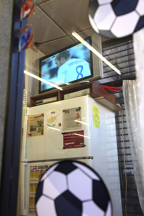Greece v Nigeria at Nicosia, Bounds Green.<br /> <br /> <br /> Copyright: Jonathan GoldbergWorld Cup 2010 watched  on London TV<br /> Greece v Nigeria, Palmers Green