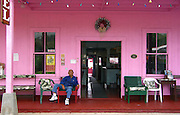 Living sample of times begone hotel. The owner sits in the front, but not too many guests seem to be around. Holualoa, Island of Hawaii.