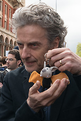 © Licensed to London News Pictures. 22/04/2017. London, UK. Doctor Who actor PETER CAPALDI holds a keyring featuring a bat taking in the March For Science demonstration to raise awareness restoring science to what is considered to be its rightful place. Photo credit: Ray Tang/LNP