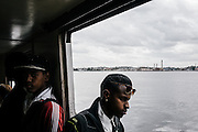 Cubans ride the commuter ferry back to Havana from Regla, a commercial and industrial suburb including shipyards in the port of Havana.
