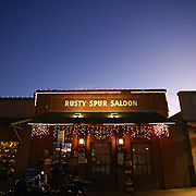"""SHOT 12/18/2007 - The Rusty Spur Saloon Scottsdale's promotes itself as the """"last real cowboy saloon"""". A registered historic landmark the saloon is the former location of Farmers Bank of Scottsdale 1921 ? 1931, closed during the Depression, but the old bank vault is still there, holding liquor instead of money. Known as one of the three happiest places in the U.S. - Disneyland, Las Vegas, and the Rusty Spur Saloon... 'Where the party never ends!!!' Patronized by John Wayne, Clint Eastwood, Jennifer Aniston, Vince Vaughn, Dierks Bentley, and John Rich (Big & Rich). Scottsdale, Az. is a city in Maricopa County, Arizona, United States, adjacent to Phoenix. Scottsdale has become internationally recognized as a premier and posh tourist destination, while maintaining its own identity and culture as """"The West's Most Western Town."""" What had, in the twentieth century been vacant desert, was converted to urban or suburban environment. The 2000 Census found the city's population to be 202,705, while according to the 2007 Census Bureau estimates, the population of the city was 240,410. Includes images of Old Town Scottsdale..(Photo by Marc Piscotty/ © 2007)"""
