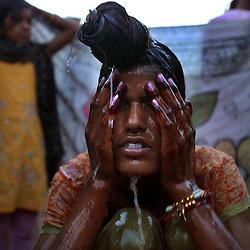 Radha Bhamwari, 15, bathes before her wedding begins in Rajasthan, India on April 27, 2009.
