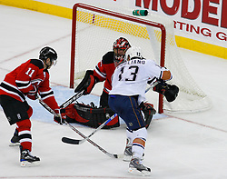 Nov 9, 2008; Newark, NJ, USA; New Jersey Devils goalie Scott Clemmensen (35) makes a save on Edmonton Oilers center Andrew Cogliano (13) during the third period at the Prudential Center. The Oilers defeated the Devils 2-1.