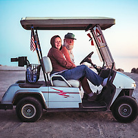 Buck and Naomi Griffis watch the sunset in their golf cart at Bombay Beach on the eastern shore of the Salton Sea. Naomi is Buck's daughter, who was visiting her father in Bombay Beach.