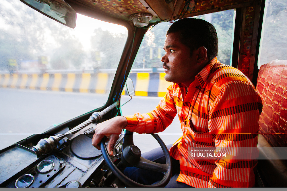 Traveling in the city in an auto rickshaw in Lucknow, Uttar Pradesh, India