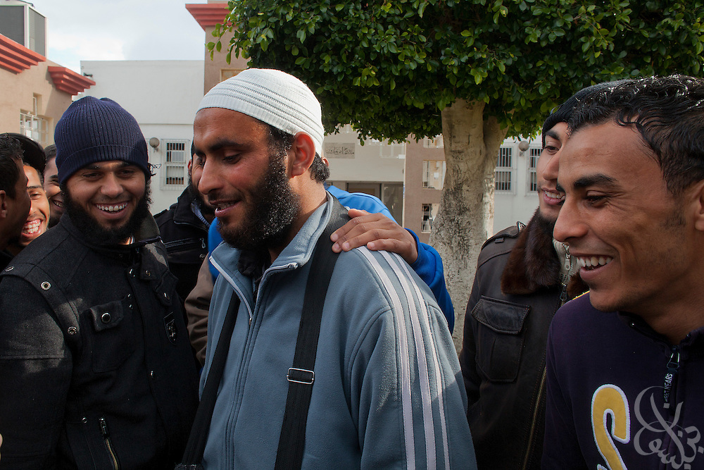 Tunisian Salafi students gather during a class break on the grounds of the Manouba University March 05, 2012 on the outskirts of Tunis, Tunisia. Recently the university has been the scene of rowdy protests by Islamist students and Salafists who opposed the deans decision to ban Muslim women from wearing the niqab in classes.