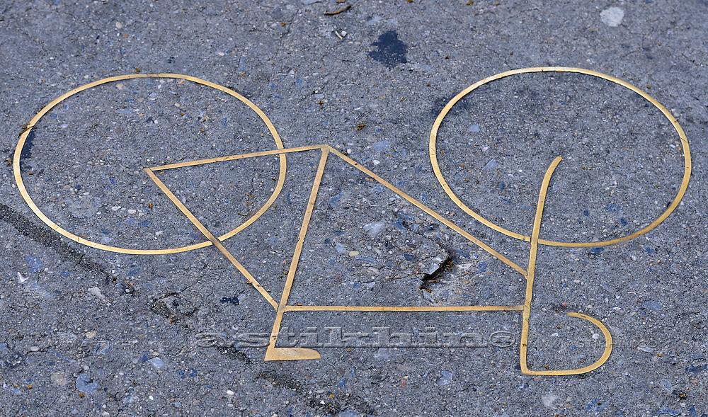 Asphalt road with yellow bike logo.
