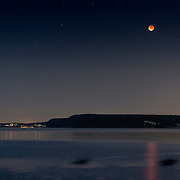 Kayakers (the dark blurs on water) watch the full moon total eclipse on Sequim Bay, WA. It was a perigee moon (when the moon is closest to Earth) and a total lunar eclipse which coincided for a few hours, resulting in a total eclipse of the largest full moon of the year. Although these astronomical events can happen separately several times a year, this combination has only happened five times since 1900, with the last coming in 1982. If you missed this one, you won't get another chance until 2033!