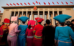 Delegates in ethnic minority costumes arrive for the opening session of the National Peoples Congress (NPC) in the Great Hall of the People in Beijing, China, on 05 March 2011. The NPC has over 3,000 delegates and is the world's largest parliament or legislative assembly though its function is largely as a formal seal of approval for the policies fixed by the leaders of the Chinese Communist Party.