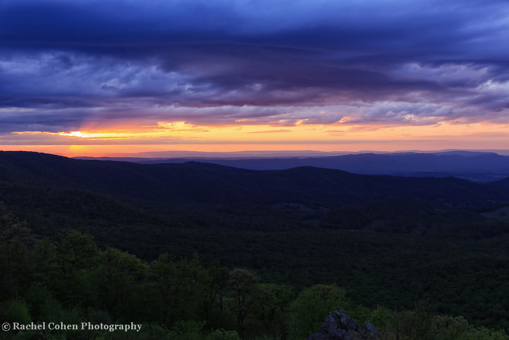 &quot;Day is Done Gone the Sun&quot;<br /> <br /> The end to a beautiful day over the Shenandoah Valley. Lovely clouds and colors above the ridges!!<br /> <br /> The Blue Ridge Mountains by Rachel Cohen