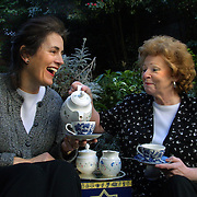 (LtoR) Carmel Ross and Judith Bennett enjoy a spot of tea and good conversation as they relax in the garden of their Brittish Tea Graden shop at 725 SW 10th.