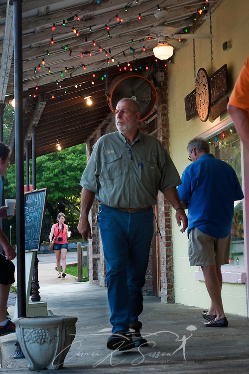 Lynn Hewlett, owner of Taylor Grocery, walks across the restaurant's porch, July 31, 2011, in Taylor, Mississippi. Taylor Grocery was founded more than a century ago, and the restaurant — famous for its fried catfish — opened in 1977. (Photo by Carmen K. Sisson/Cloudybright)