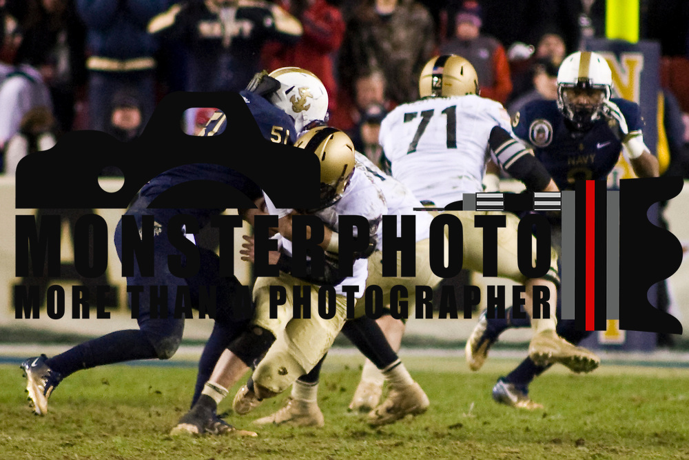 Navy Linebacker Matt Warrick #51 (left)  sacks Army quarterback Trent Steelman #8 for loss of 5 yards at the NAVY 29 in the 4th quarter of the 112th version of this storied rivalry Saturday, Dec. 10, 2011 at Fed EX field in Landover Md.<br /> <br /> Navy set the tone early in the game as Navy defeats Army 31-17 in front of 82,000 at Fed EX Field in Landover Md...