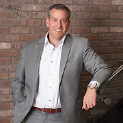 Executive portrait of Tony Oliverio shot on location in Calgary, Alberta.